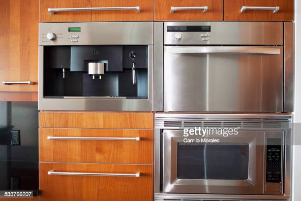 Ovens, microwave and cabinets in modern kitchen