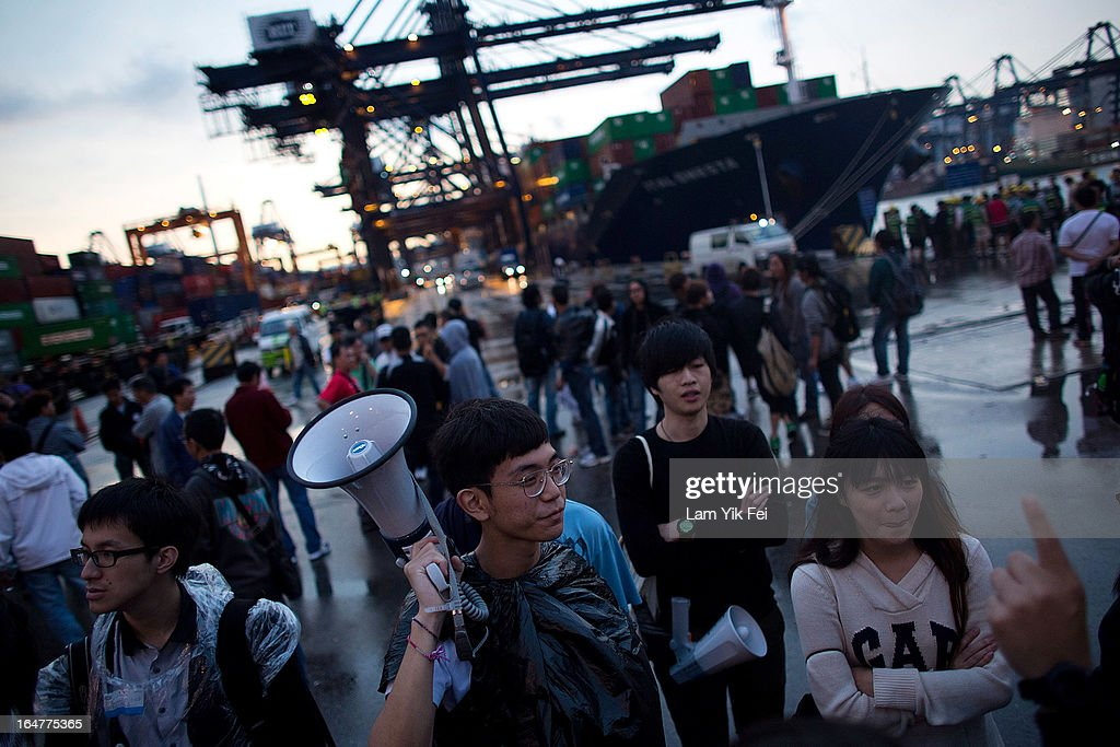 Over 100 dock workers stage a sit-in as they go on strike over pay at the Kwai Chung Container Terminal on March 28, 2013 in Hong Kong, China. The workers, who are employed by the Hongkong International Terminals, are demanding higher wages, claiming that they have not received a pay rise for 15 years.