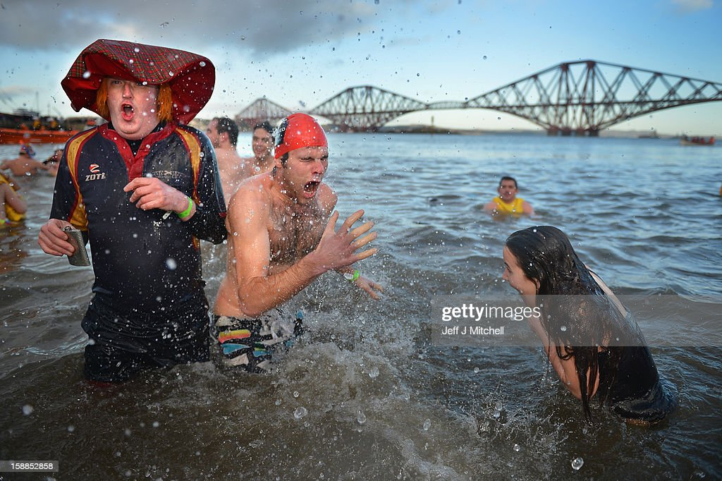 Over 1,000 New Year swimmers, many in costume, braved freezing conditions in the River Forth in front of the Forth Rail Bridge during the annual Loony Dook Swim on January 1, 2013 in South Queensferry, Scotland. Thousands of people gathered last night to see in the New Year at Hogmanay celebrations in towns and cities across Scotland.