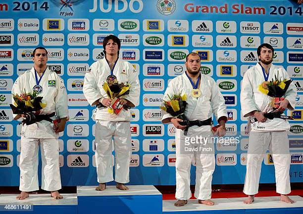 Over 100kg medallists LR SilverDavid Moura BRA GoldRyu Shichinohe JPN BronzeFaicel Jaballah TUN and Renat Saidov RUS during the Paris Grand Slam on...