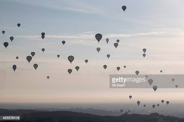 Over 120 hot air balloons depart from Aston Court in a mass ascent on the first full day of the Bristol International Balloon Fiesta on August 8 2014...