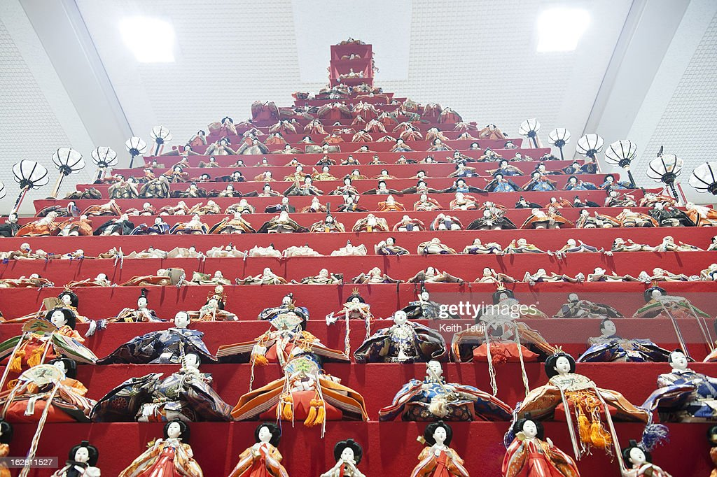 Over 1,700 Hina Dolls are displayed on huge 31-story pyramid on February 27, 2013 in Konosu City Hall, Saitama, Japan. The Japanese Doll Festival (Hina Matsuri) or Girls' Day, is held on March 3rd. Platforms covered with red carpet are used to display a set of ornamental dolls representing the Emperor, Empress, attendants, and musicians in traditional court dress of the Heian period.