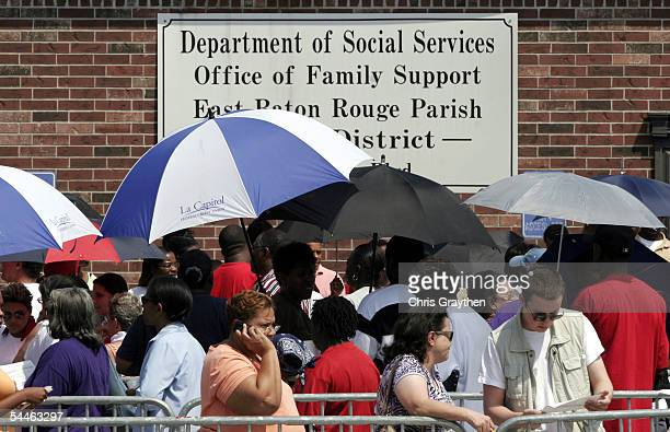 Over 200 people line up at the Baton Rouge Department of Social Services to register for emergency Aid after Hurricane Katrina on September 3 2005 in...