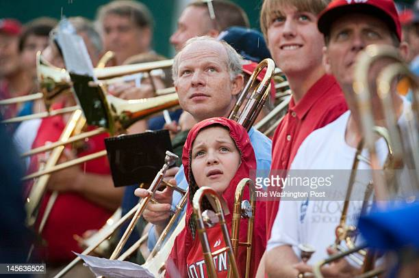 Over 300 trombonists watch themseleves on the jumbotron to see themselves perform the song 76 Trombones on the Washington Nationals baseball field in...