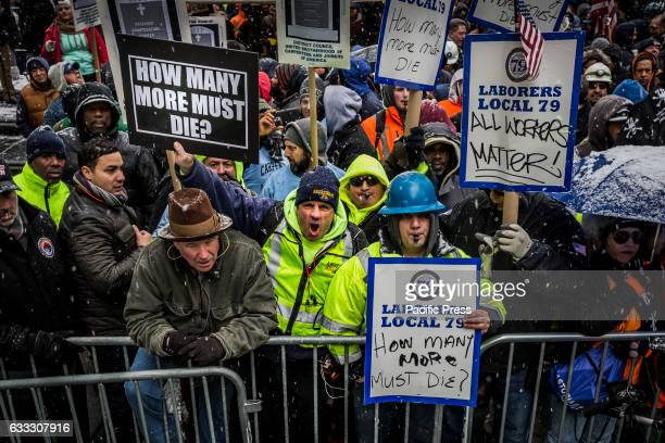 Over 30000 members of New York City's Building Trades walked off their jobs to rally outside of City Hall calling for better safety legislation In...