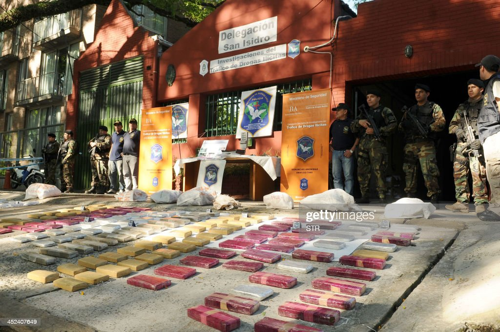Over 400 kilograms of marijuana are displayed after being seized by the Buenos Aires province police in different raids on November 28, 2013 in Buenos Aires. Five people were arrested in the operations, one of whom is a Paraguayan citizen.