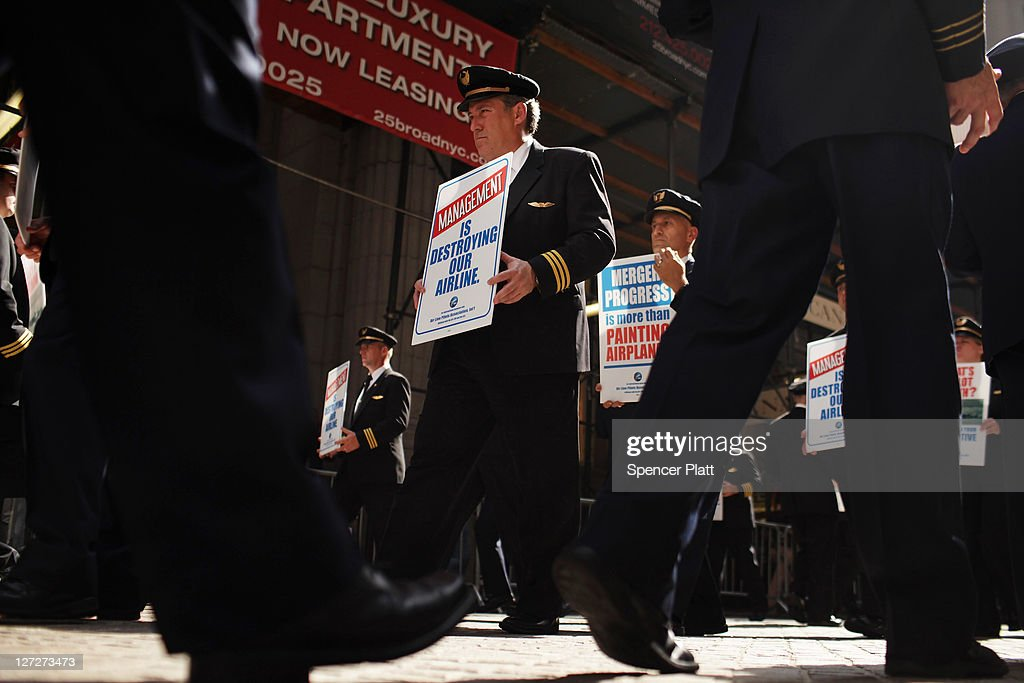 Over 700 hundred Continental and United pilots, joined by additional pilots from other Air Line Pilots Association (ALPA) carriers, demonstrate in front of Wall Street on September 27, 2011 in New York City. The pilots want to draw attention to the lack of progress on negotiations of the pilots' joint collective bargaining agreement ahead of the one-year anniversary of the corporate merger close date of United and Continental airlines.