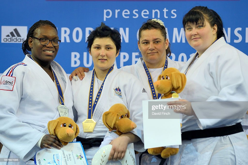 Over 78kgs medallists (L-R) silver medalist Emilie Andeol (France), gold medalist <a gi-track='captionPersonalityLinkClicked' href=/galleries/search?phrase=Lucija+Polavder&family=editorial&specificpeople=5128390 ng-click='$event.stopPropagation()'>Lucija Polavder</a> (Slovenia), bronze medalists Belkis Zehra Kaya (Turkey) and Iryna Kindzerska (Ukraine) pose with their medals during the Budapest European Championships at the Papp Laszlo Sports Hall on April 27, 2013 in Budapest, Hungary.