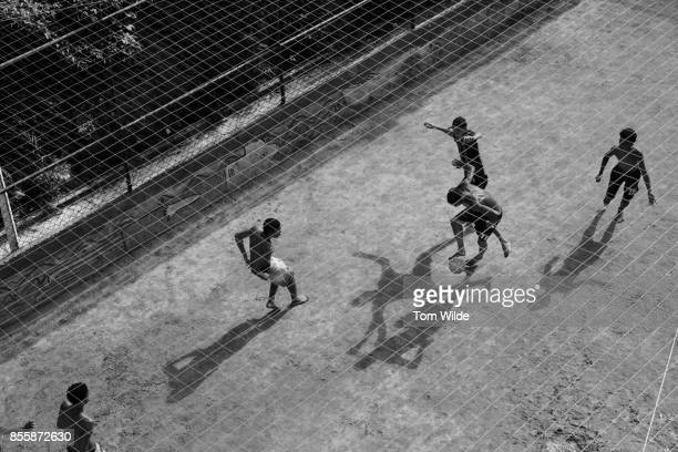 Over head shot of young men playing football