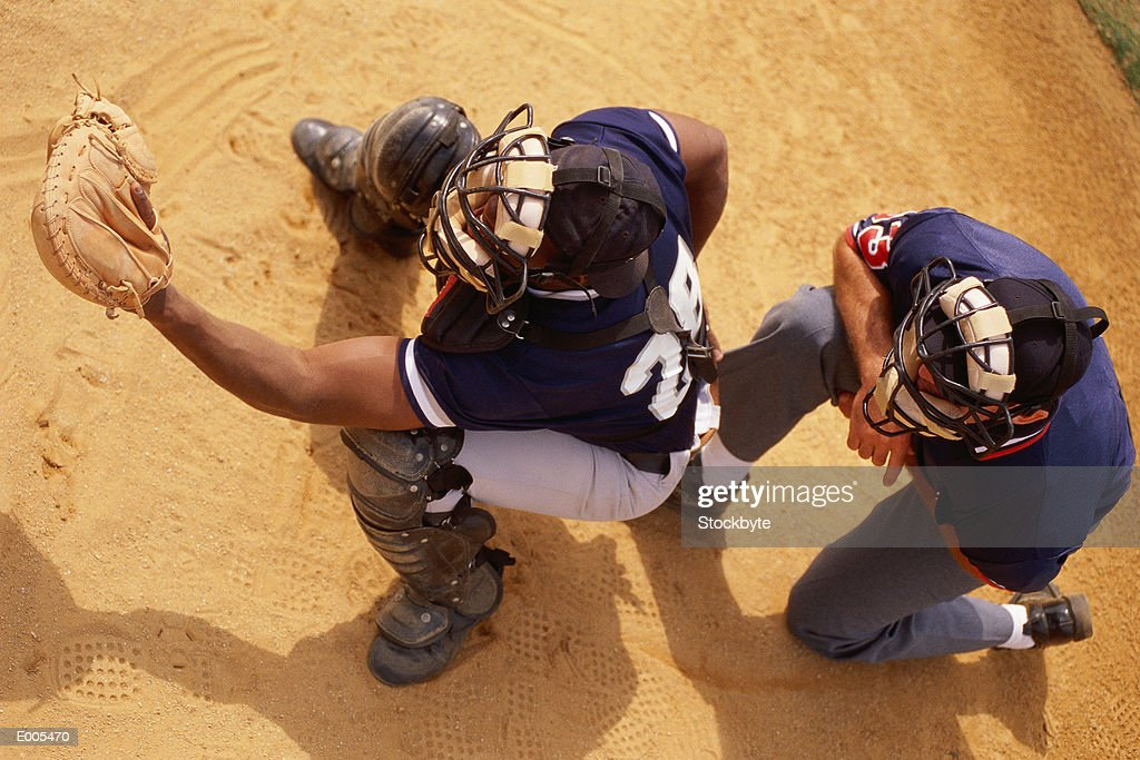 Over head view of catcher with umpire behind : Stock Photo