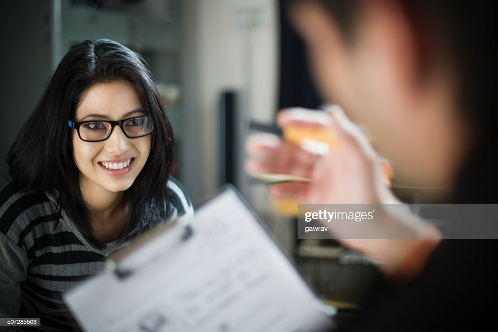 Over shoulder view of happy businesswoman listening to her colleague. : Stock Photo