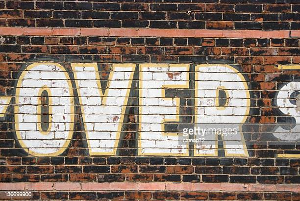 Over Sign, Word Painted Large on Brick Wall
