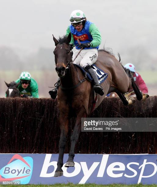 Over the Creek riden by Christian Williams jumps the last to win the Boylesportscom Cashback Handicap Chase at Cheltenham Racecourse