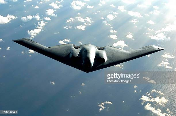 Over the Pacific Ocean - A B-2 Spirit bomber soars during a deployment to Andersen Air Force Base, Guam.