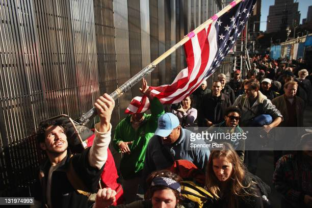 Over twenty members of the Occupy Wall Street movement leave Zuccotti Park and begin a highway hike to Washington DC on November 9 2011 in New York...