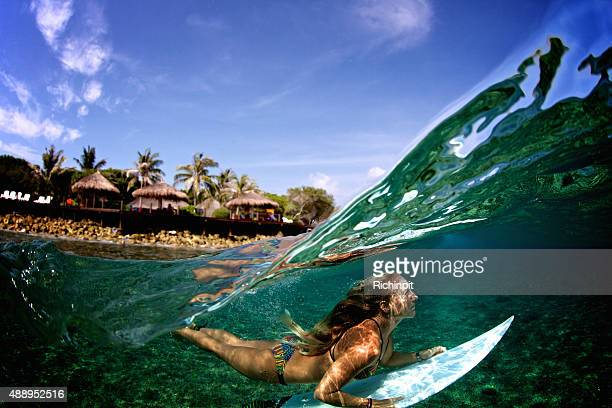 Over under duck dive of a surfer girl