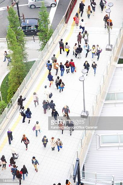 Over view of people walking on bridge