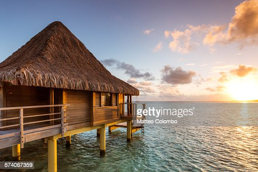 Over water bungalow at sunset, Rangiroa, Polynesia