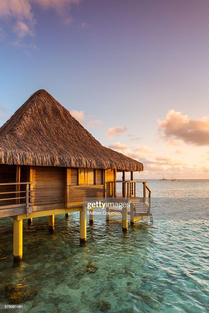 Over water bungalow at sunset, Rangiroa, Polynesia