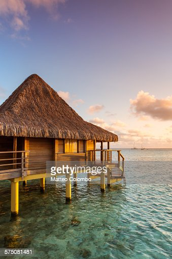 Over water bungalow at sunset rangiroa polynesia stock - Rangiroa urlaub ...