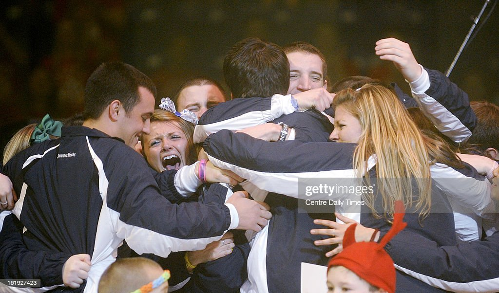 Overall committee members scream and hug with excitement after announcing the grand total raised for the Four Diamonds fund through the 2013 Penn State IFC/Panhellenice Dance Marathon was $12,374,034.46, in State College, Pennsylvania. The total was announced to the capacity Bryce Jordan Center, following the 46 hours of dancing on Sunday, February 17, 2013.