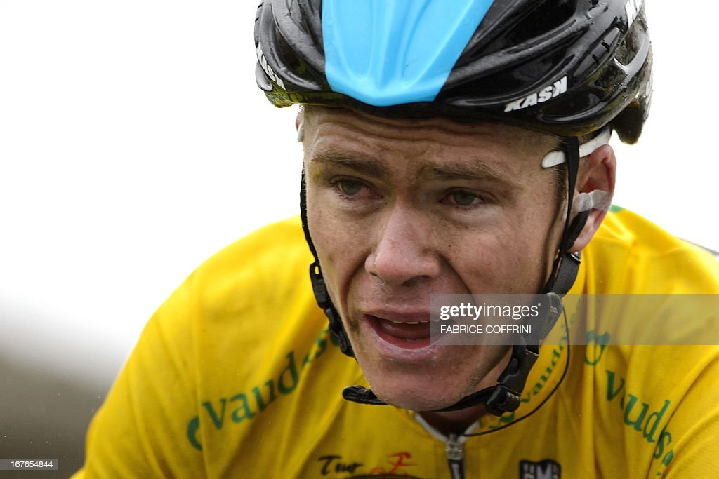 Overall leader Christopher Froome of Britain reacts after placing second during the fourth stage of the Tour de Romandie cycling race on April 27, 2013 in Les Diablerets. Froome tightened his grip on the yellow jersey as he finished just behind Simon Spilak of Slovenia after 188.5km from Marly to Les Diablerets.