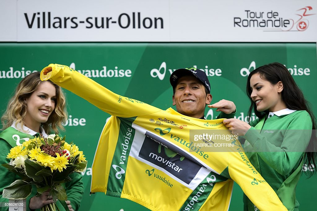 Overall leader Colombian Nairo Quintana wears his yellow jersey during the podium ceremony in the fourth stage of the 70th Tour de Romandie UCI World Tour, a 172,7 km race between Conthey to Villars-sur-Ollon, on April 30, 2016 in Villars-sur-Ollon, western Switzerland. / AFP / FABRICE