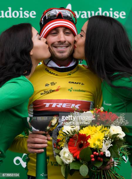 Overall leader Italy's Fabio Felline of team TrekSegafredo is kissed by hostesses after the second stage of Tour de Romandie UCI protour cycling race...