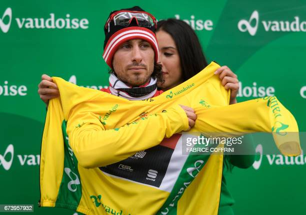 Overall leader Italy's Fabio Felline of team TrekSegafredo wears his yellow jersey after the second stage of Tour de Romandie UCI protour cycling...