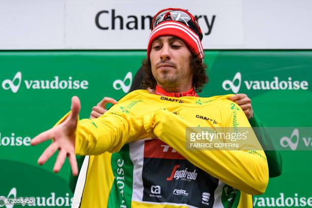 Overall leader Italy's Fabio Felline of TrekSegafredo team pulls on the yellow jersey after the first stage of Tour de Romandie UCI protour cycling...