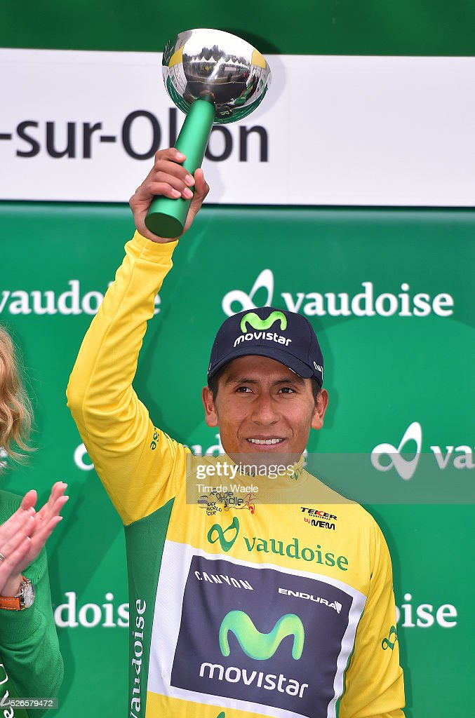 Overall leader <a gi-track='captionPersonalityLinkClicked' href=/galleries/search?phrase=Nairo+Quintana&family=editorial&specificpeople=8831308 ng-click='$event.stopPropagation()'>Nairo Quintana</a> of Colombia celebrates in the yellow jersey on the podium after stage 4 of the Tour de Romandie on April 30, 2016 in Villars-sur-Ollon, Switzerland.