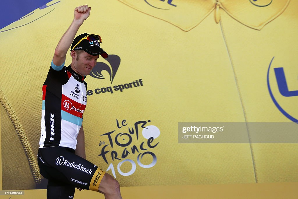 Overall leader's yellow jersey Belgium's Jan Bakelants arrives on the podium to celebrate his overall leader yellow jersey at the end of the 145.5 km third stage of the 100th edition of the Tour de France cycling race on July 1, 2013 between Ajaccio and Calvi, on the French Mediterranean Island of Corsica.