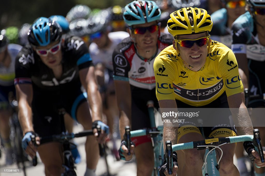 Overall leader's yellow jersey Belgium's Jan Bakelants (R), Luxembourg's Andy Schleck (C), and Britain's Christopher Froome (L) ride during the 145.5 km third stage of the 100th edition of the Tour de France cycling race on July 1, 2013 between Ajaccio and Calvi, on the French Mediterranean Island of Corsica. AFP PHOTO / JOEL SAGET