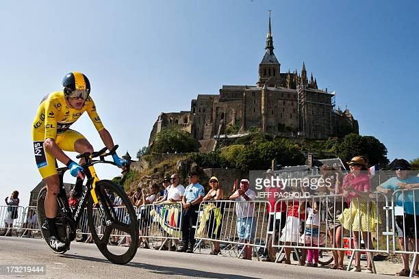 Overall leader's yellow jersey Britain's Christopher Froome competes during the 33 km individual timetrial and eleventh stage of the 100th edition of...