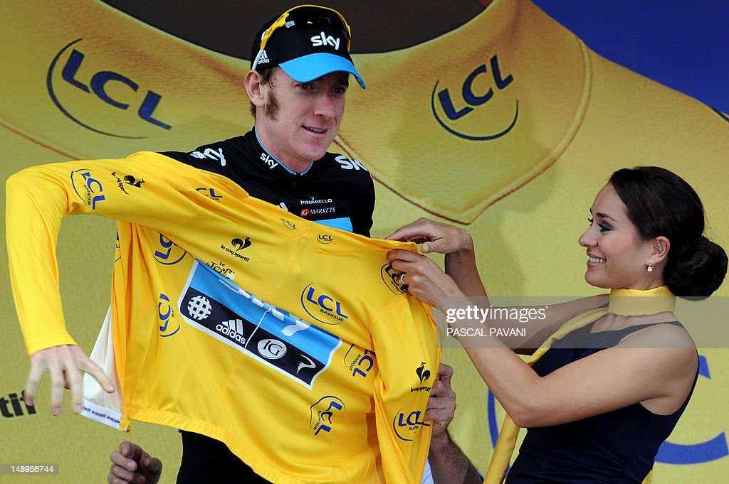 Overall leader's yellow jersey, British Bradley Wiggins, celebrates on the podium at the end of the 222,5 km and eighteenth stage of the 2012 Tour de France cycling race starting in Blagnac and finishing in Brive-la-Gaillarde, southwestern France, on July 20, 2012.