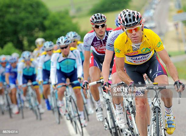 Overall leader's yellow jersey holder Australian Cadel Evans leads the pack on June 8 2009 in the second stage of the 61th edition of the Criterium...