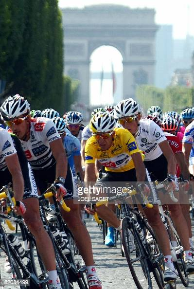 Overall leader's yellow jersey Spanish coteam leader Carlos Sastre rides in the pack on the ChampsElysees Avenue on July 27 at the end of the 143 km...