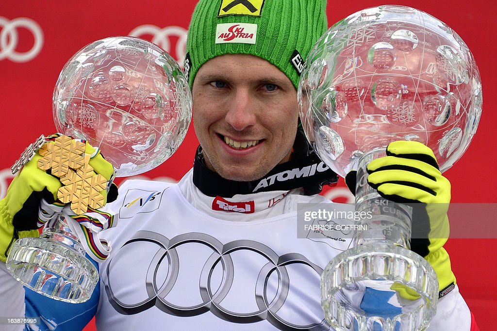 Overall men World Cup Winner Ausria's Marcel Hirscher poses with his two Crystal globes trophies at the Alpine ski World Cup finals on March 17, 2013 in Lenzerheide. AFP PHOTO / FABRICE COFFRINI