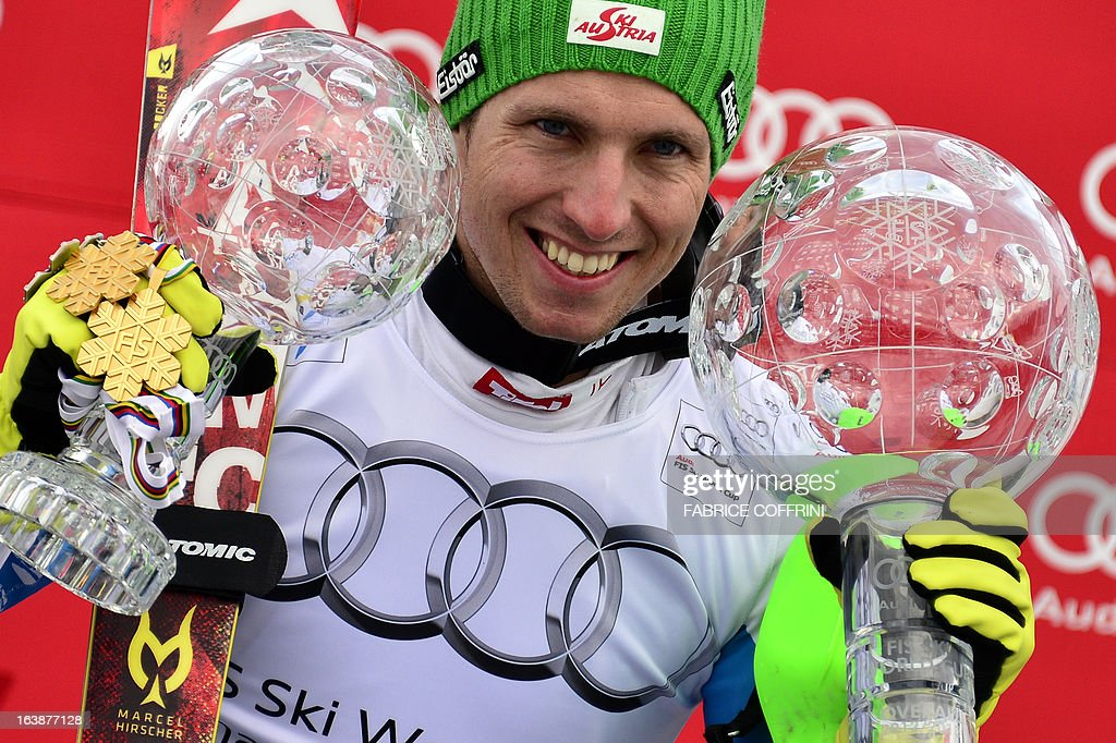 Overall men World Cup Winner Ausria's Marcel Hirscher poses with his two Crystal globes trophies at the Alpine ski World Cup finals on March 17, 2013 in Lenzerheide.