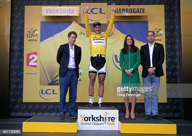 Overall race leader Marcel Kittel of Germany and Team GiantShimano is presented by Prince Harry Catherine Duchess of Cambridge and Prince William...