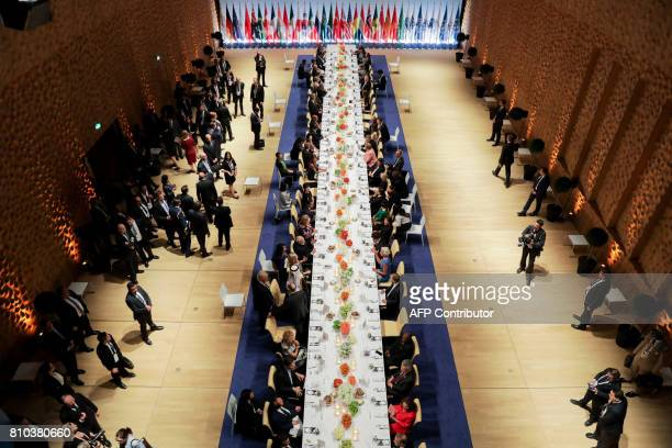Overall view of the participants of the G20 summit and their spouses attending the banquet after a concert at the Elbphilharmonie concert hall during...