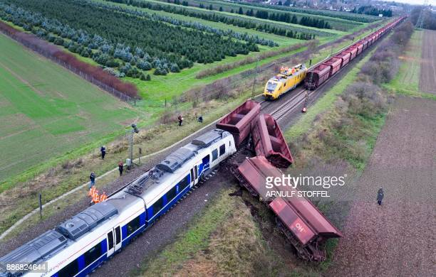 TOPSHOT Overall view taken with a drone on December 06 2017 shows the site of a train accident in MeerbuschOsterath western Germany where a passenger...