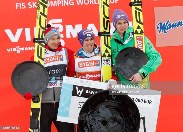 Overall winner of RAW AIR ski jumping tournament Stefan Kraft from Austria flanked by second placed Kamil Stoch from Poland and third placed Andreas...