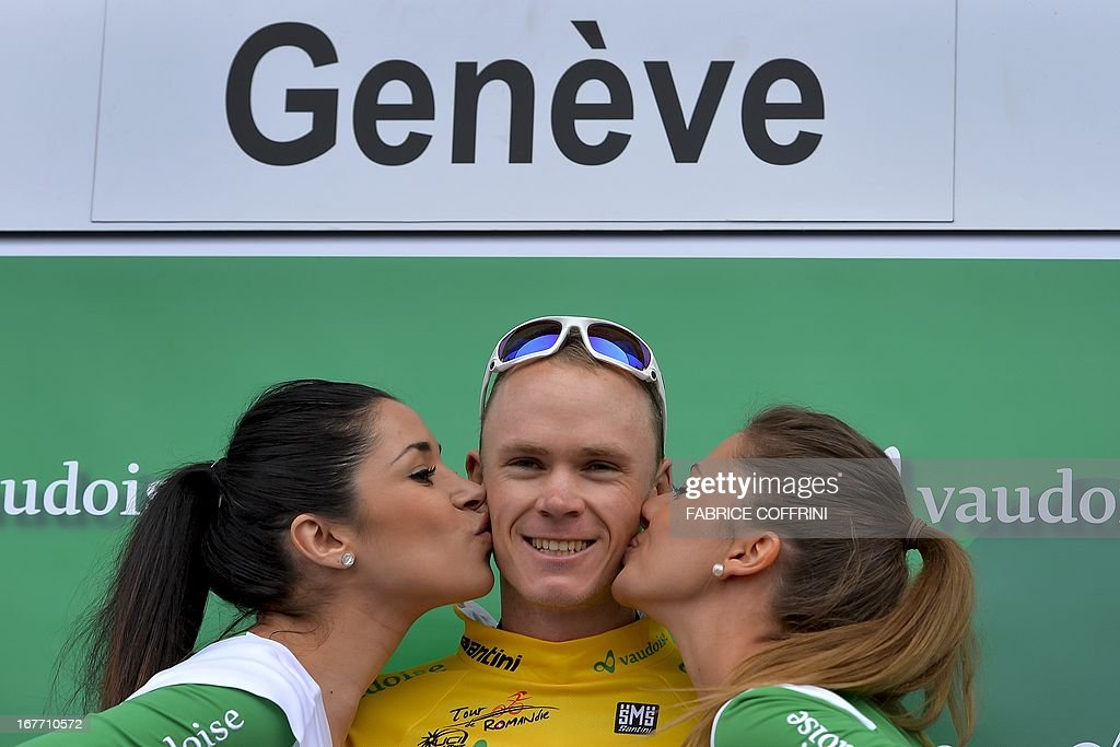 Overall winner of the Tour de Romandie cycling race, Christopher Froome of Great Britain is kissed by hostesses during the podium ceremony after the final stage, a 18,7 km race against the clock, on April 28, 2013 in Geneva. The 27-year-old Team Sky cyclist - the Olympic time-trial bronze medalist and second in last year's Tour de France - had 54 seconds to spare over second-placed Slovenian Simon Spilak while Portugal's Rui Costa filled third spot just as he did last year. AFP PHOTO / FABRICE COFFRINI