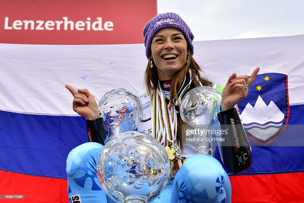 Overall women World Cup Winner Tina Maze of Slovenia poses with her three Crystal globe trophies at the Alpine ski World Cup finals on March 17, 2013 in Lenzerheide.