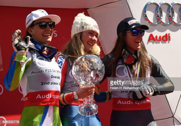 Overall World Cup champion Mikaela Shiffrin of the United States middle laughs with second place finisher Ilka Stuhec of Slovenia left and third...