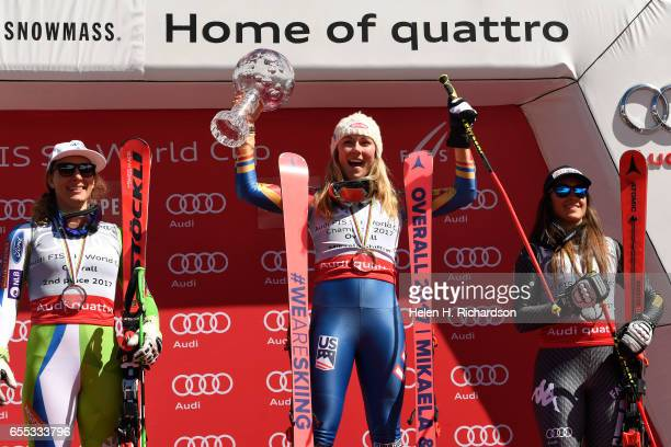 Overall World Cup champion Mikaela Shiffrin of the United States middle cheers with second place finisher Ilka Stuhec of Slovenia left and third...