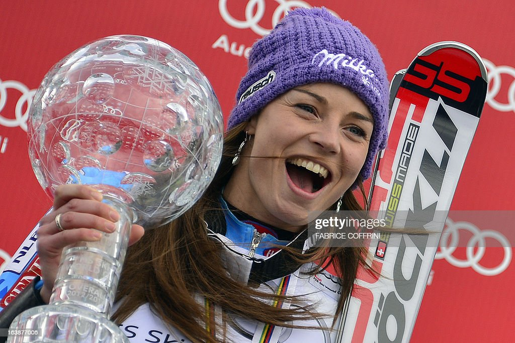 Overall World Cup winner Tina Maze of Slovenia celebrates with her Cystal Gobe trophy at the Alpine ski World Cup finals on March 17, 2013 in Lenzerheide.