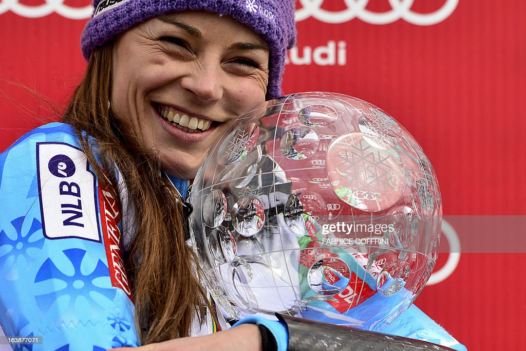 Overall World Cup winner Tina Maze of Slovenia celebrates with her Cystal Gobe trophy at the Alpine ski World Cup finals on March 17, 2013 in Lenzerheide. AFP PHOTO / FABRICE COFFRINI