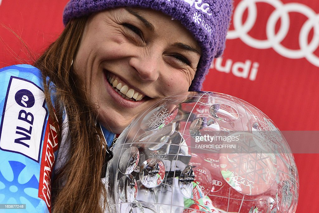 Overall World Cup winner Tina Maze of Slovenia celebrates with her crystal globe trophy at the Alpine ski World Cup finals on March 17, 2013 in Lenzerheide.